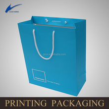 ladys carry clothing bag/chinese factory OEM production customized paper bag