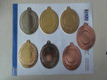 round gold embossed sport medals and trophys