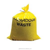 yellow asbestos waste packaging plastic garbage bag with asbestos warning logo