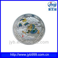 Silver metal coin with chinese dragon