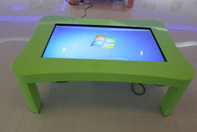 Children touch interactive teaching digital signage tables