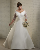 white lace ball gown long sleeve plus size wedding dress