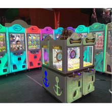 Low price popular crane claw electronic coin game machine