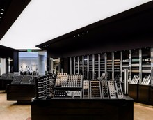 Modern glossy black paint store design for cosmetics