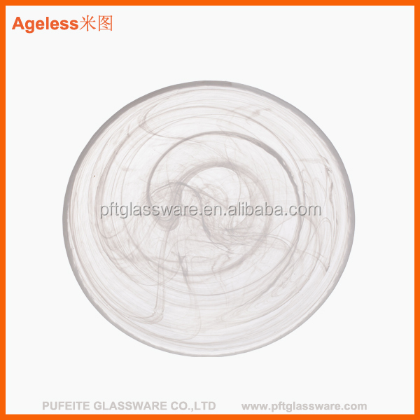 clear round glass dinner plates with flower design