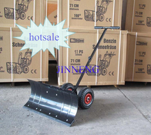 Stretching adjustable push snow shovel with wheels