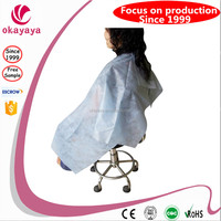 Hot sales Hairdressing Salon Cape Disposable PP Nonwoven Capes Barber Cloth Gown hair cutting cape