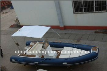 Rigid inflatable boat with teak floor