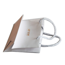Custom foldable flat handle kraft paper bag fashion shopping bag with pp rope handle