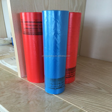 Biodegradable plastic garbage bags in roll red and blue