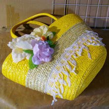 Bright yellow color natural straw bag with lace and flowers for shopping