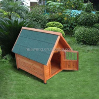 wooded dog house with asphalt roof
