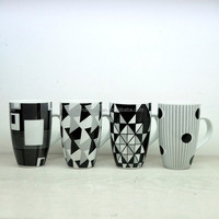 white and black ceramic drink mug