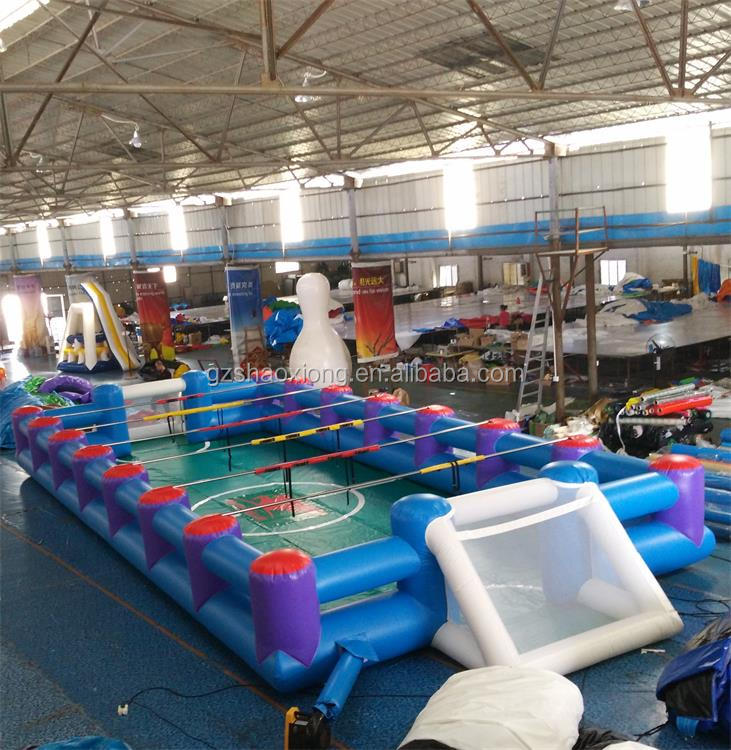 Factory price inflatable human foosball court,outdoor inflatable table football field for sport game race