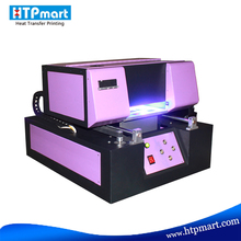 Hot selling A4 uv flatbed printer, printer uv, mobile phone covers printing machine and pvc id card printing
