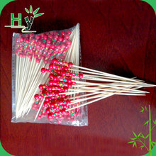Bamboo party fruit picks with double red balls