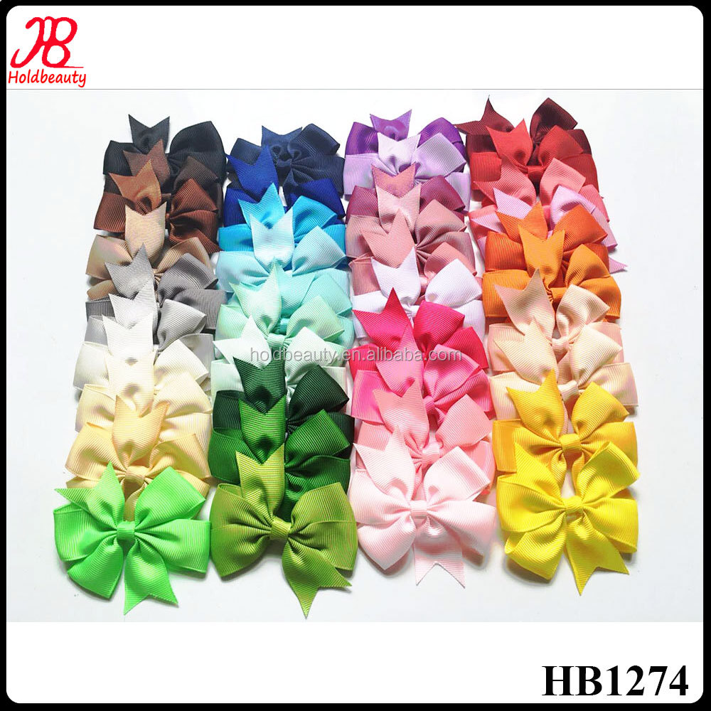 solid color ribbon pinwheel hair bow with alligator clips