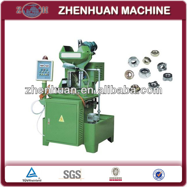 Nut tapping threading machine