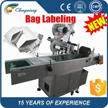 Hot sell 2015 hot automatic plastic bag labeling machine