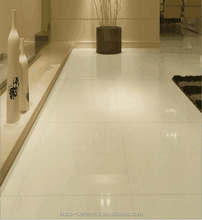 china foshan 600*600mm cheap glossy soluble salt tile with ivory color