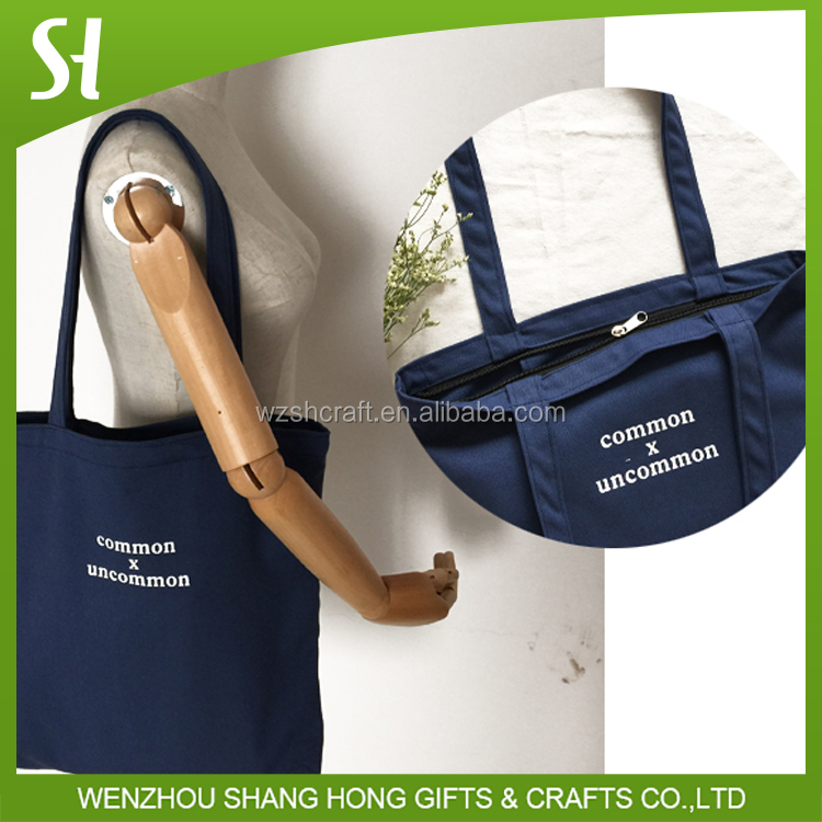 navy bag type and waxed canvas tote bag with zipper closure