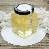 Flat square glass jar with black metal lid for sale
