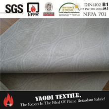 Fire retardant drapery fabric