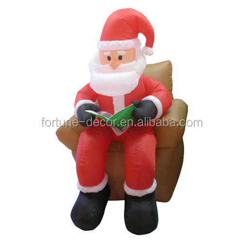 4ft inflatable Santa claus sitting on sofa