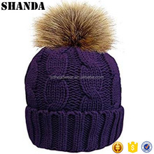Ladies chunky soft cable knit hat with cosy fleece liner and detachable faux fur pompom