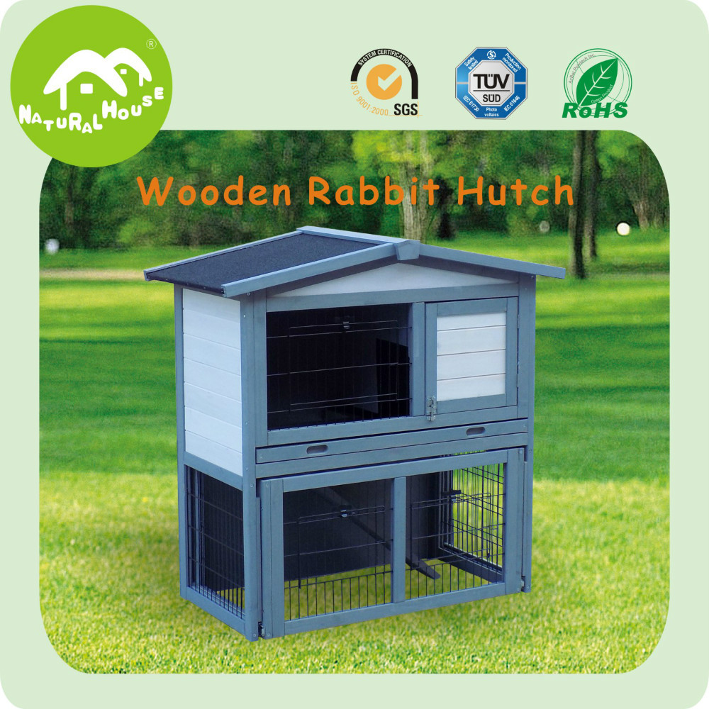 white 2 story wooden rabbit hutch