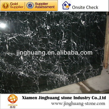white vein in black marble slab and tile
