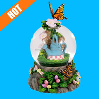 Orange and Black Butterfly in the Garden Glass Musical Snow Globe