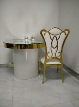 Golden High grade stainless steel coffee table and chairs with good design