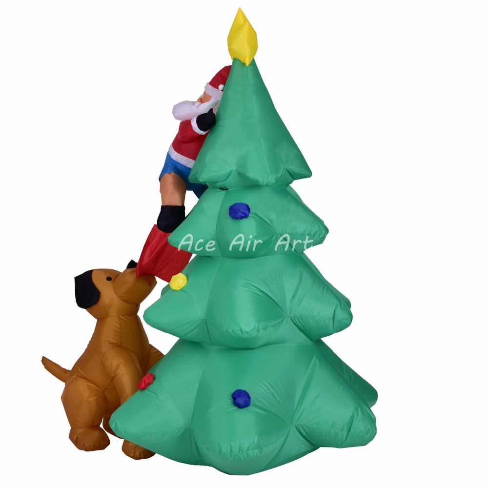 inflatable Santa was chased by a dog and climbed the tree Christmas for Christmas decoration