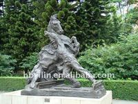 Ancient hero fighting with horse urban sculpture