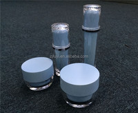 Shiny blue plastic creme jars with screw cap and bottles