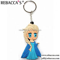 Anniversary girl and boy character soft pvc plastic key charm key chain gift for new book publishment Soft Pvc Key Charm