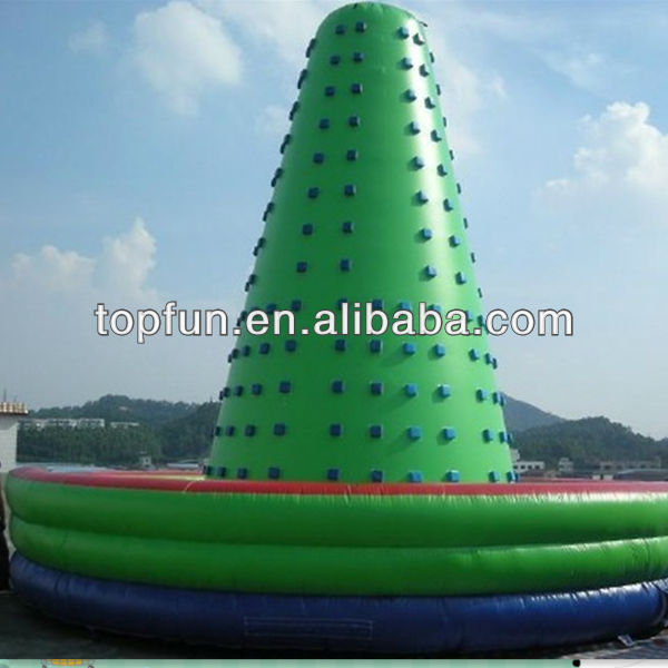 Giant green outdoor inflatable climbing wall