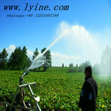 Agriculture boom spraying water wheel irrigation for garden / farmland