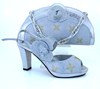 Latest Italian sexy ladies evening Silver high heel shoes and matching bags for women