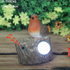 resin cuckoo statue with motion sensor and solar light