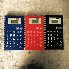 school notebook with calculator and pen