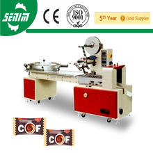 With CE High Speed Hot Sale SM600 Full Automatic Bonbons Candy Wrapping Machine