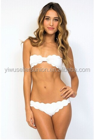 Strapless raw scallop bikini top has signature gold metal back hook closure.
