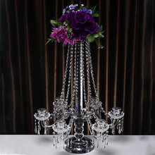 beautiful wedding center pieces hanging crystal candelabras and flower stands