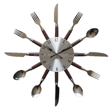kitchen clock with knife and fork shape