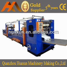 V-folded hand towel paper machine with glue-lamination
