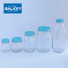 different size clear glass mason jars with screw top lid