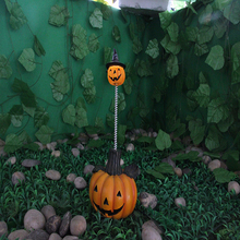 halloween resin crafts decorating with pumpkins outdoors