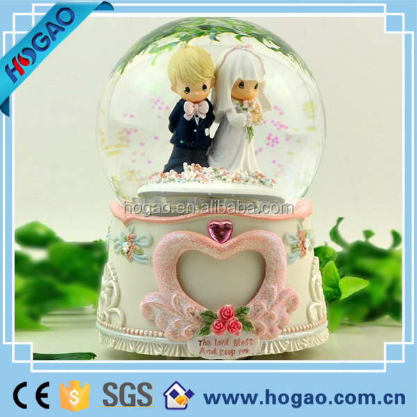 Resin custom snow globe for wedding